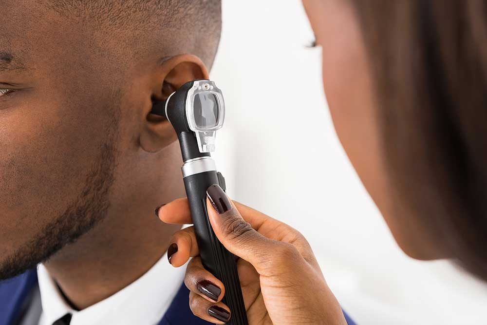audiologist working